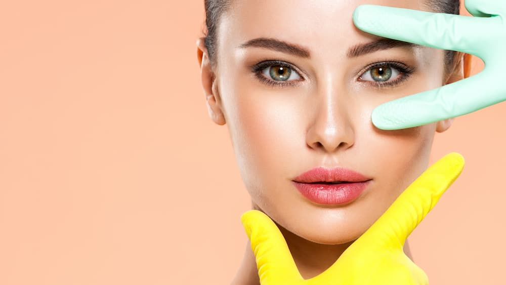 Portrait-of-beautiful-girl-which-touching-her-fresh-face.-Face-skin-check-before-plastic-surgery1